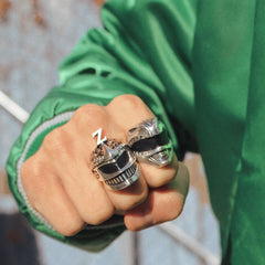 the sterling silver green ranger ring and lord zedd ring from the mighty morphin power rangers collection