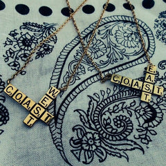 shot of a pendants from the han cholo scrabble jewelry collection