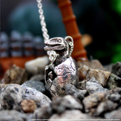 shot of the baby dino pendant from the jurassic park jewelry collection
