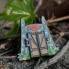 shot of the jurassic park gate pin from the jurassic park jewelry collection
