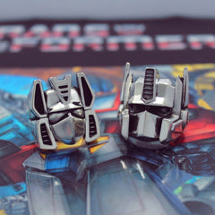 the limited edition sterling silver optimus prime and soundwave rings from the transformers generation 1 jewelry collection