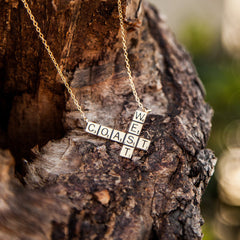 shot of a pendant from the han cholo scrabble jewelry collection