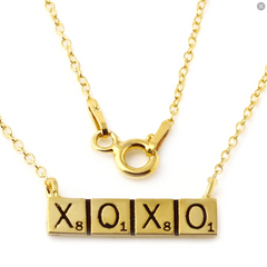 shot of the XOXO pendant from the han cholo scrabble jewelry collection
