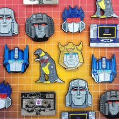the collection of the officially licensed transformers generation 1 enamel pins