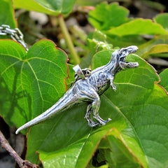 shot of the T.rex pendant from the jurassic park jewelry collection