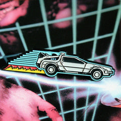 shot of the delorean pin from the back to the future jewelry collection