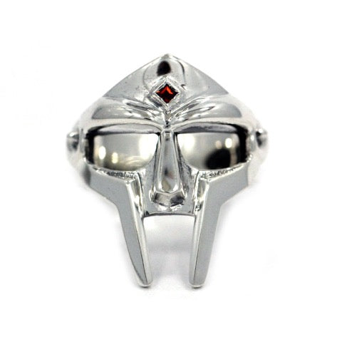 The MF DOOM Ring in sterling silver with a red garnet stone in the middle on a white background