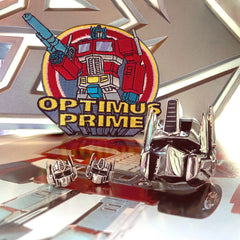 shot of the limited edition optimus prime patch and the sterling silver optimus prime earrings and ring
