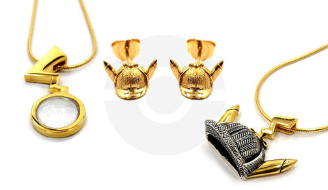SHOT OF ALL OF THE PRECIOUS METALS JEWELRY PIECES FOR THE DETECTIVE PIKACHU JEWELRY COLLECTION FEATURING THE EARRINGS AND 2 PENDANTS
