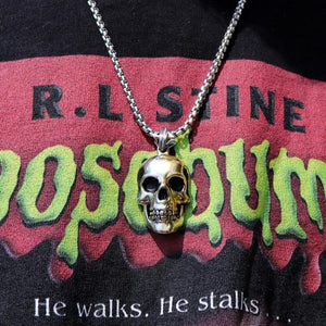 shot of the 2 tone skull pendant from the han cholo skulls collection on a goosebumps shirt