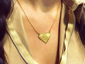 shot of the best friends squad pendant being worn on a woman with the pendant laying on her chest