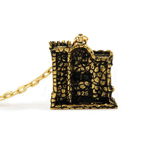 back of the castle grayskull pendant in gold from the masters of the universe collection