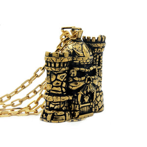left side of the castle grayskull pendant in gold from the masters of the universe collection