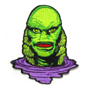 front of the Creature Lurking Patch from the universal monsters jewelry collection