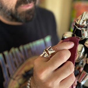 shot of a man wearing the raider ring playing the a battlestar galactica toy