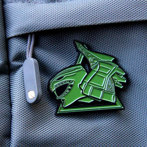 up close shot of the green ranger dragonzord enamel pin on backpack