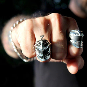 shot of the lord zedd ring and the green ranger ring on a fist in shadow and light