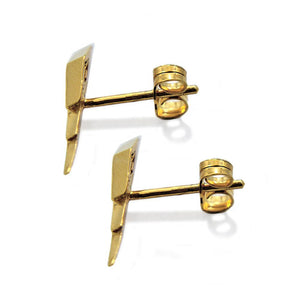 downward view of the Mighty Morphin Power Rangers Bolt Earrings in gold on a white surface