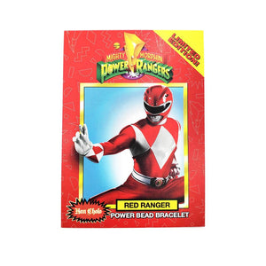 the front of the mighty morphin power rangerrs trading card showing the red ranger