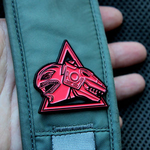 up close shot of the red ranger trex zord enamel pin on backpack strap