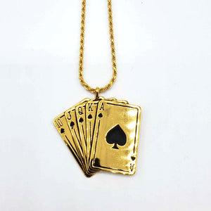 front shot of the Royal Flush Pendant in gold on a white surface