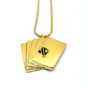 back  shot of the Royal Flush Pendant in gold on a white surface