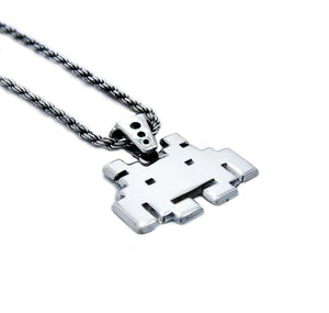 left angle view of the smiley invader pendant in silver on a white background