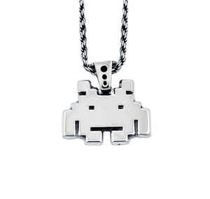 front view of the smiley invader pendant in silver on a white background