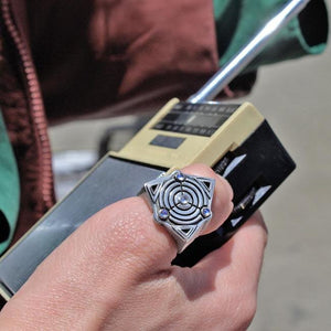 shot of a man holding a vintage radio wearing the awoken ring