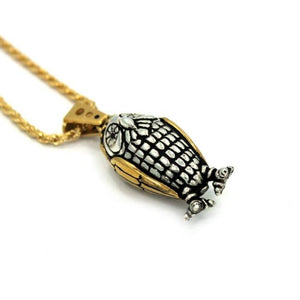 left angle of the Baby Bobo Owl Pendant from the han cholo fantasy collection