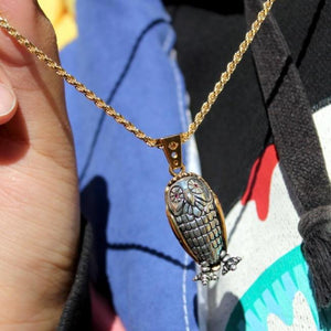 shot of a girl wearing the Baby Bobo Owl Pendant from the han cholo fantasy collection