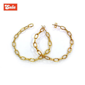front of the Baby Chain Hoop Earrings in gold from the han cholo shadow series