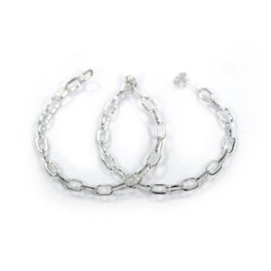 front of the Baby Chain Hoop Earrings in silver from the han cholo shadow series