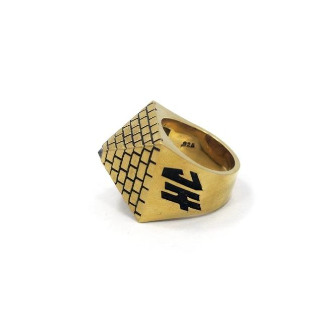 front of the Baby Pyramid Ring in gold from the han cholo precious metal collection