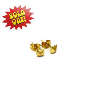 right side of the Baby Spike Stud Earrings in gold from the han cholo shadow series
