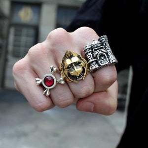 shot of a man wearing the castlegrayskull ring, skeletor armor ring and battlecat ring on his fist