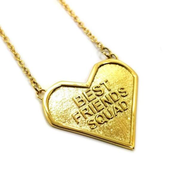 Front view of the best friends squad gold heart shaped pendant with chains on either side