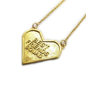 angled view of the best friends squad gold heart shaped pendant pointing to the left