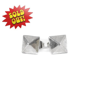 front of the big Spike Stud Earrings in silver from the han cholo shadow series