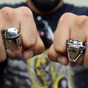 shot of a man wearing the voltron ring and boba fett ring