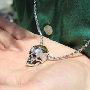 shot of a man holding the Brain Dead Pendant from the han cholo skulls collection