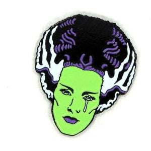 close up alngle of the bride tears enamel pin from the universal monsters jewelry collection