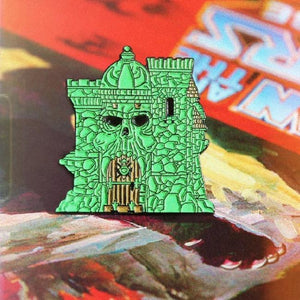 shot of the castle grayskull enamel pin on a masters of the universe book