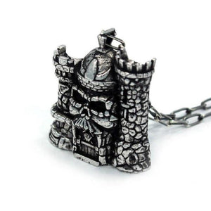 3/4 view of the castle grayskull pendant in silver from the masters of the universe collection