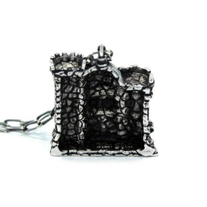 back of the castle grayskull pendant in silver from the masters of the universe collection