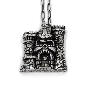 front of the castle grayskull pendant in silver from the masters of the universe collection