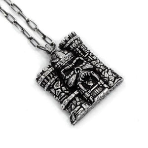 left angle of the castle grayskull pendant in silver from the masters of the universe collection