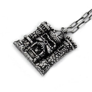 right angle of the castle grayskull pendant in silver from the masters of the universe collection
