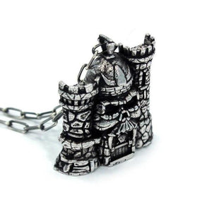 left side of the castle grayskull pendant in silver from the masters of the universe collection