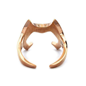 back view of the Catra helmet ring showing the open back of the ring casting a shadow